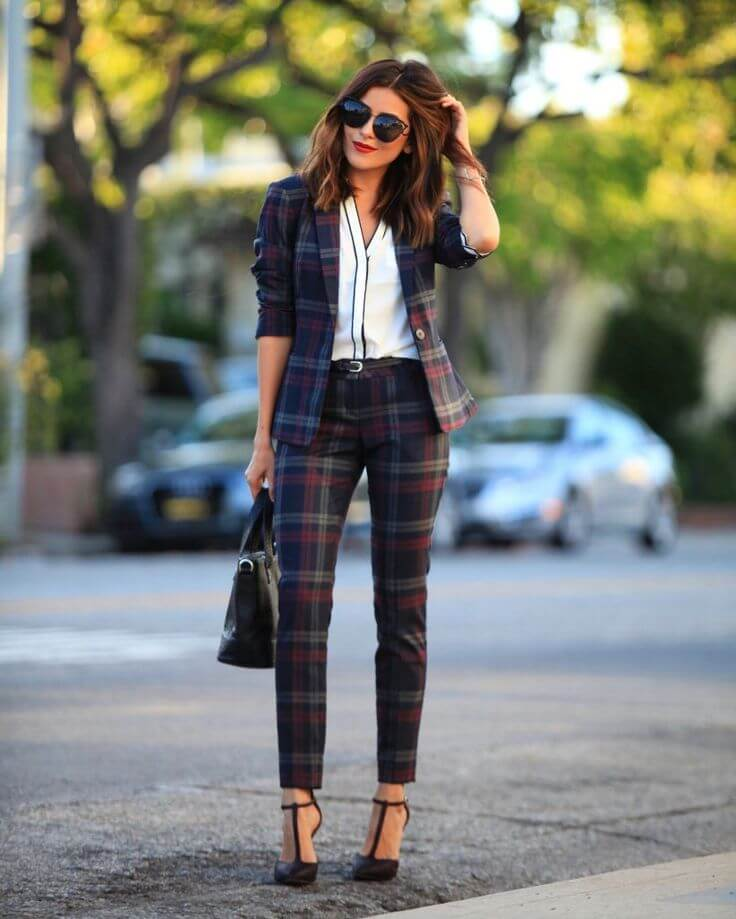 Cute girl wearing a tartan suit. The bossy girl is here!