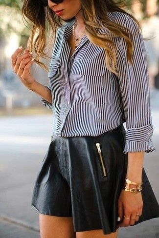 Edgy woman in black leather skirt and striped shirt. Give your button-down shirt some edgy appeal with sexy black leather.