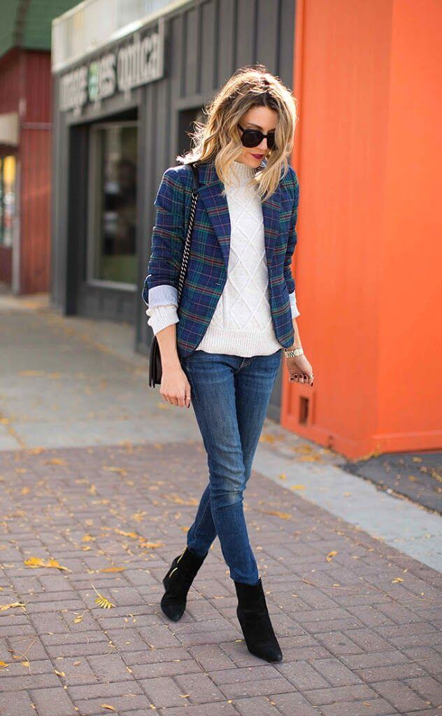 Girl in a white sweater, blue skinnies, and blue-green blazer. Save the spring!