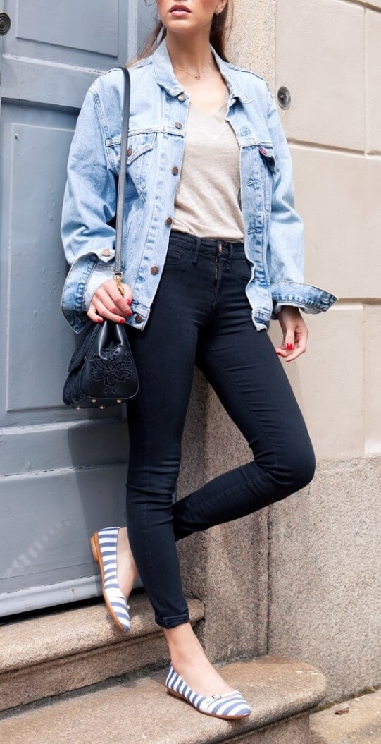 The modern woman is wearing high-waisted skinny jeans and vintage Levi's jacket. Get that cool urban persona by pairing trendy denim separates with classic blue-and-white stripes.