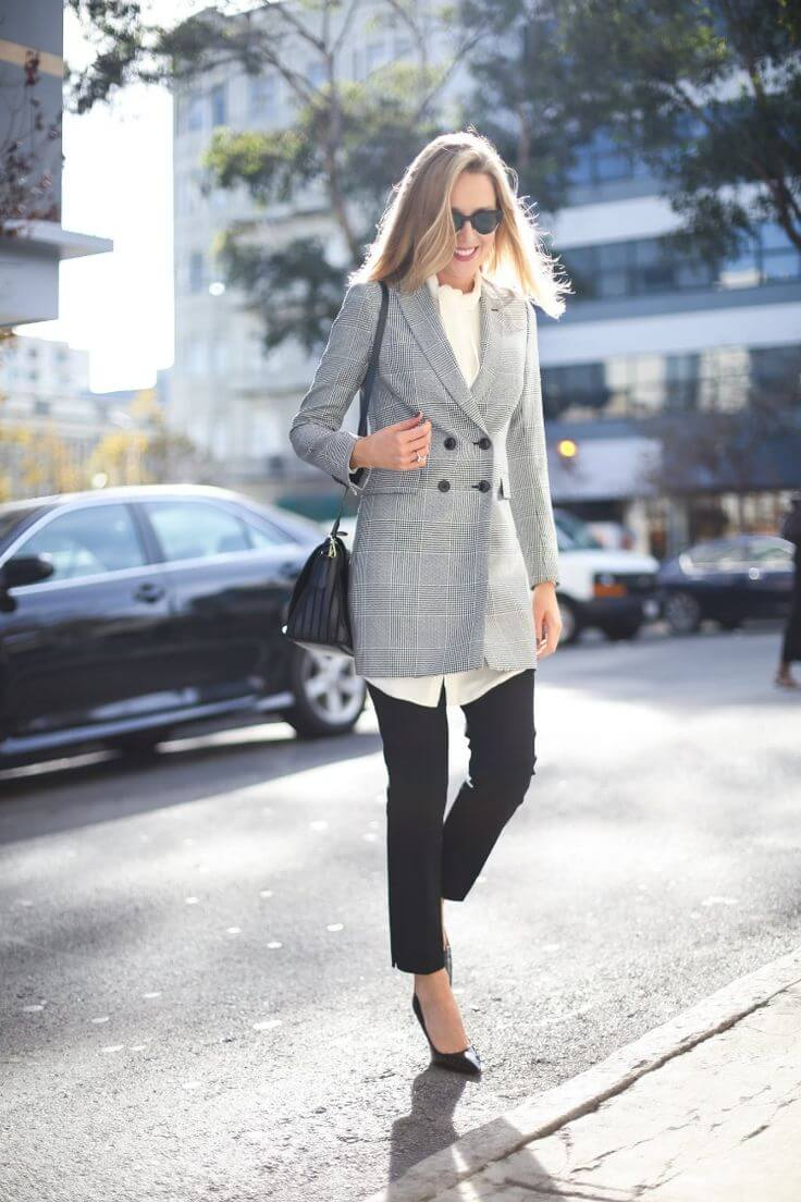 Young professional wearing a long white shirt, black ankle pants, and long double-breasted glen plaid blazer. Borrowed from your boyfriend, because it looks better on you!