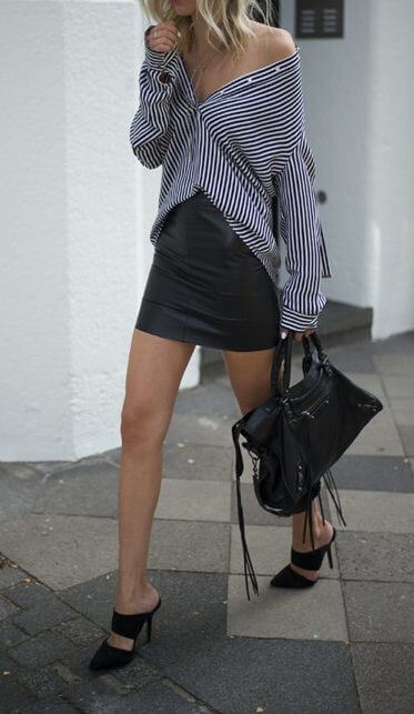 Stylish blonde in black leather skirt and striped shirt. Give your black leather mini skirt a facelift with classic vertical stripes.
