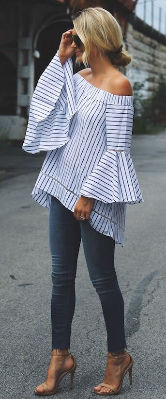 Stylish blonde in skinny jeans and striped off-the-shoulder top. This top combines all the major spring trends into one look.