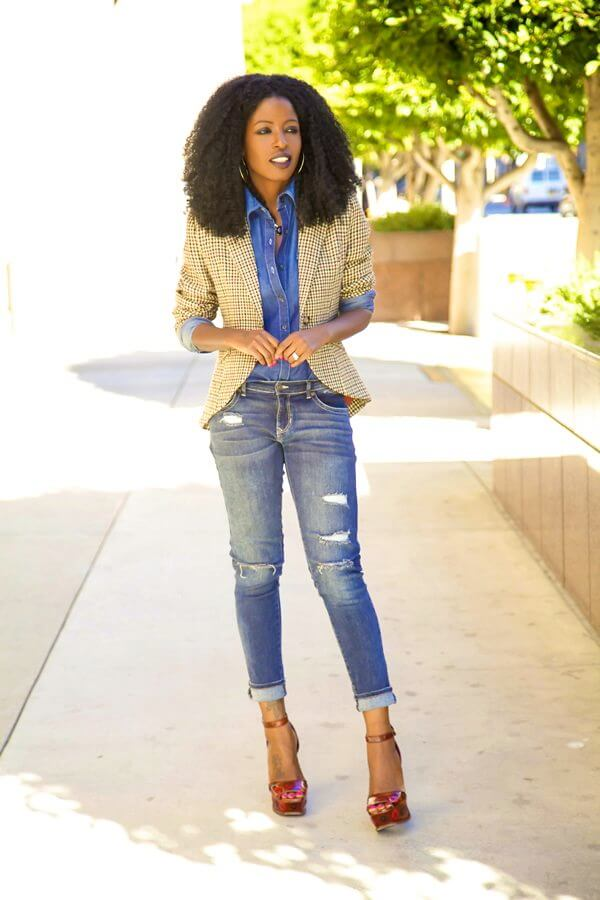 A woman in total denim look with a cool tartan blazer and red heels