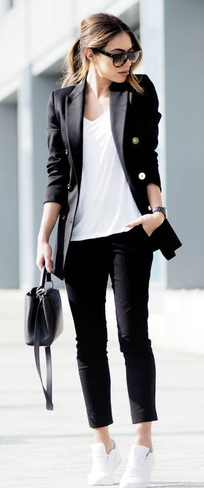 Stylish woman is wearing cropped pants and a double-breasted blazer. Androgynous style is a winner no matter the weather.