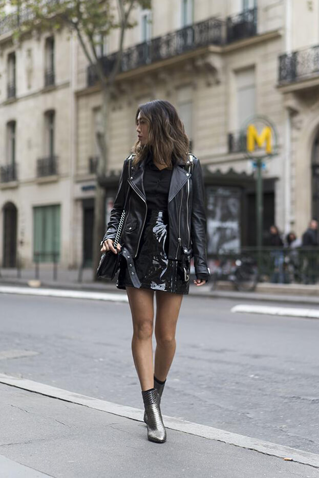 What a femine look: patent leather mini skirt, leather biker jacket, button down top and ankle boots