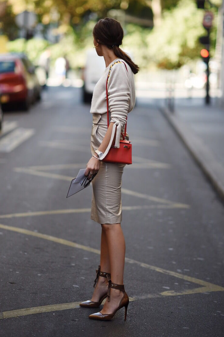 Brunette is wearing the leather beige pencil skirt and cashmere sweater with cognac leather pumps