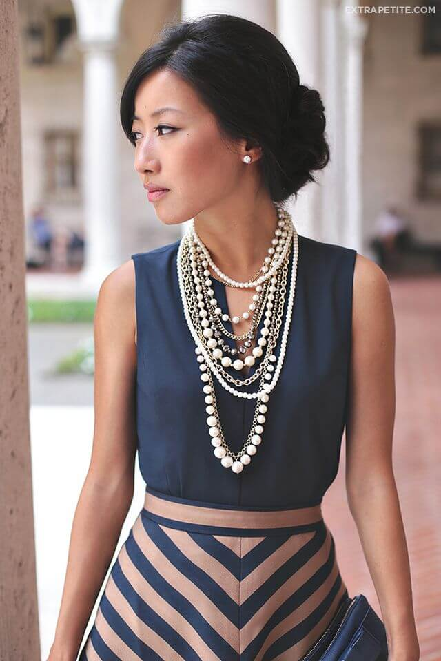 Caramel and navy blue dress with impressive cascade pearls necklace
