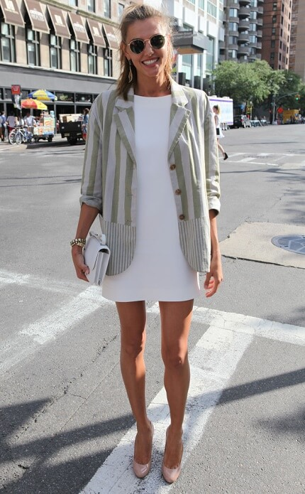Dress up a plain white shift dress with a cool jacket