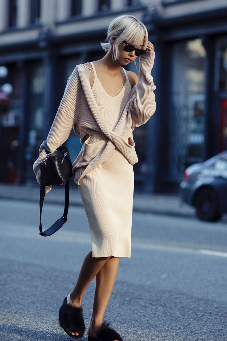 The great example of monochromatic outfit which created from the stretch-knit dress of desert color, the same tint cardigan, and feather mules slippers