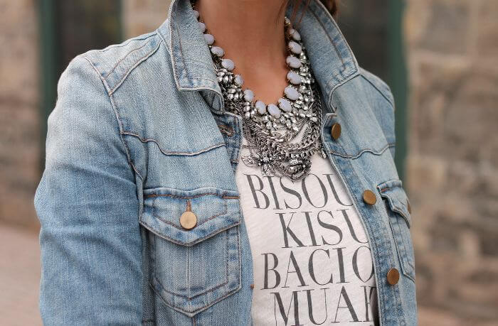 Graphic t-shirt matched with three different necklaces in silver color