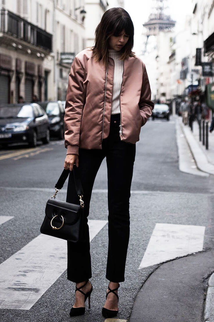 Talisa Sutton of Badlans wearing a dusty pink jacket, vintage Levi's jeans, black straight leg pants, black suede pumps with crisscrossing straps.