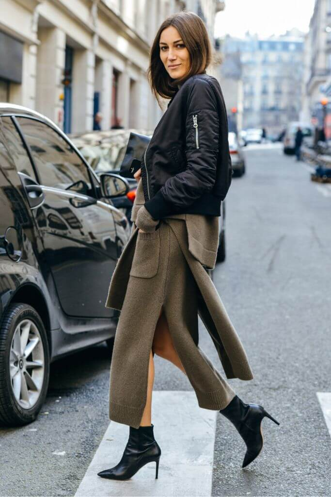 Outfit details — Acne black bomber jacket, khaki-green wool maxi skirt & sweater, black leather ankle boots.