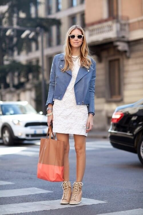 Adding color to your little white dress is always a good idea. So, throw on a fun jacket and some lace-up boots