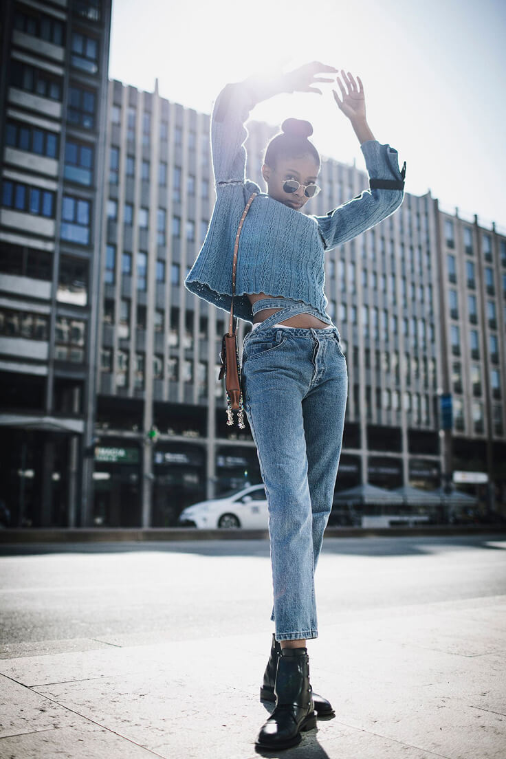 Denim is always denim. Here we see jeans with the crisscross denim belt straps and sweater with bell sleeve knit, ankle-high black leather boots