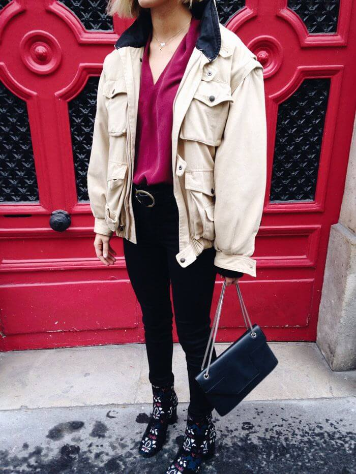 Blogger is showing how to combine silk top, vintage bomber jacket, Levis jeans, Isabel Marant boots and Saint Laurent leather bag.