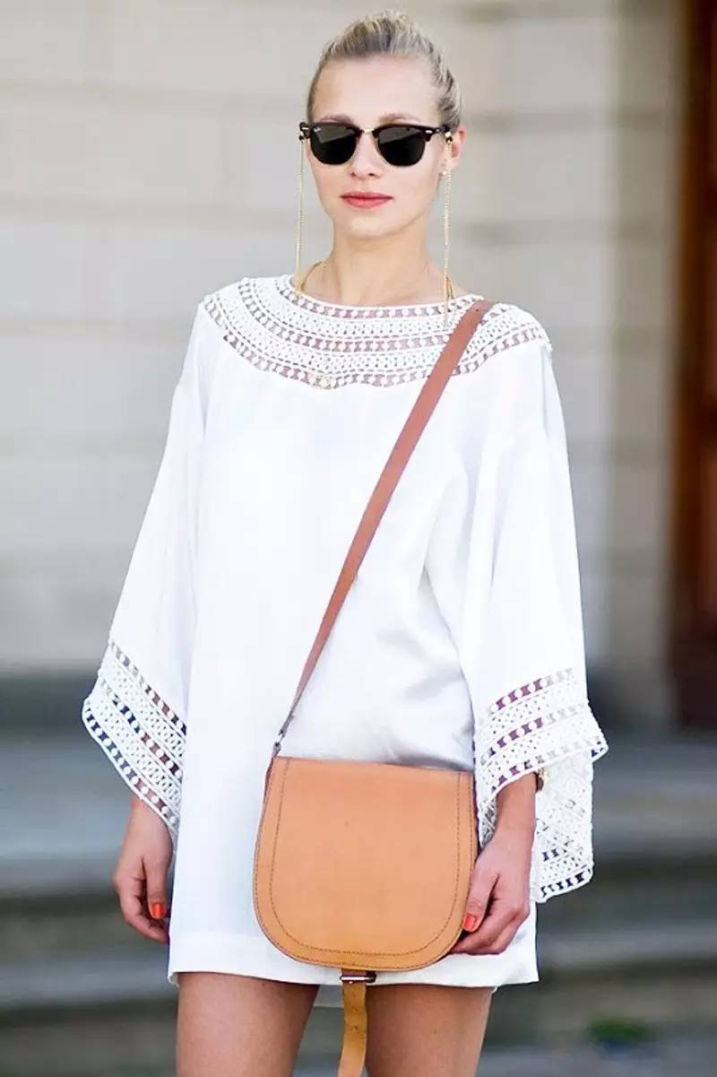 White and tan go together like wine and cheese. A boho white dress calls for boho accessories. We love the extra-long earrings and of course the simple tan bag