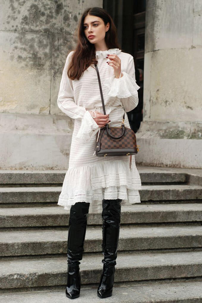 Wearing white embroidered belted dress with patent leather overknee boots