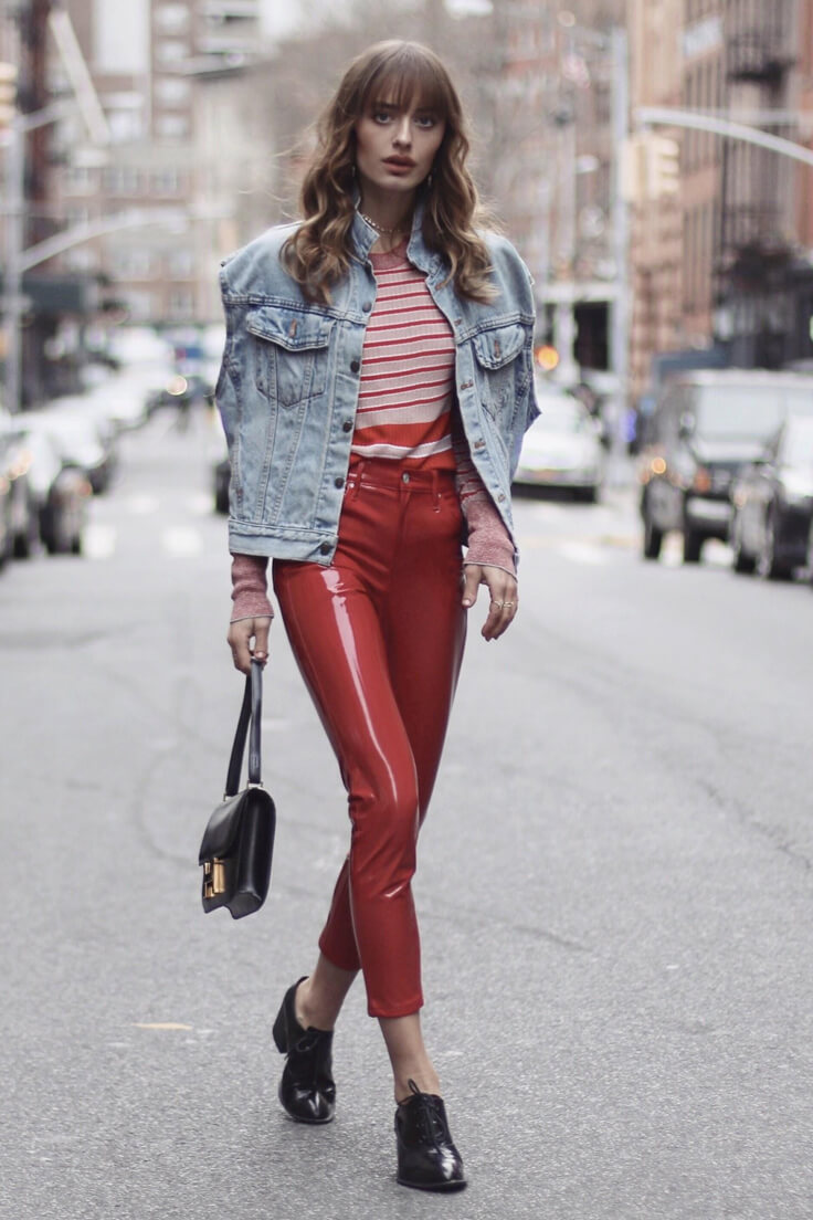 Sonya Esman puts together red striped knit under vintage denim vest, red vinyl pants, and black leather lace-up oxfords