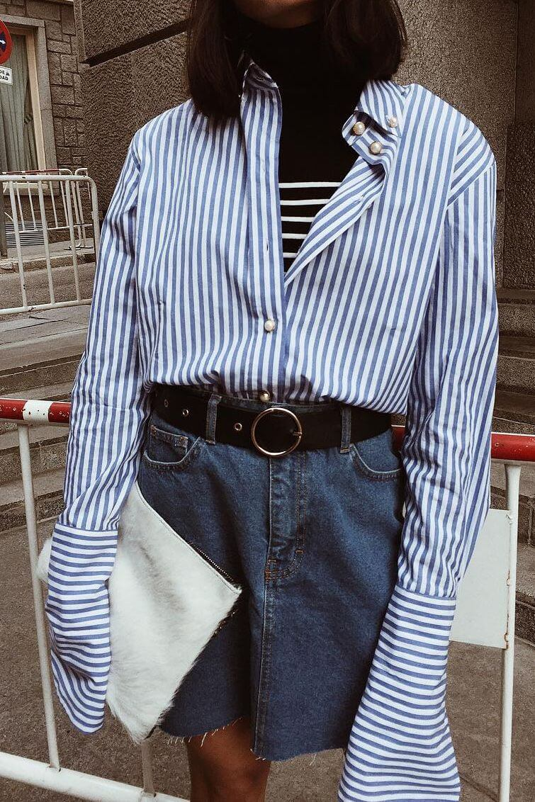 Maria Bernad's outfit details — black turtleneck under striped long sleeves shirt & denim mini skirt with a wide black belt