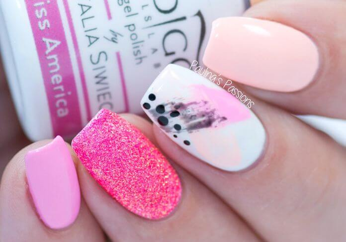 Incorporate a bit of abstract art into your manicure using the dry brush technique over a white base using different shades of pink. Add a glitter accent nail like the one shown here if you're feeling fancy, or repeat the same abstract design on each nail.