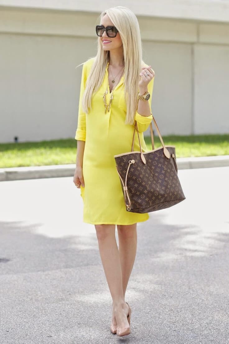 Blondie dressed in satin shirt dress in fresh yellow