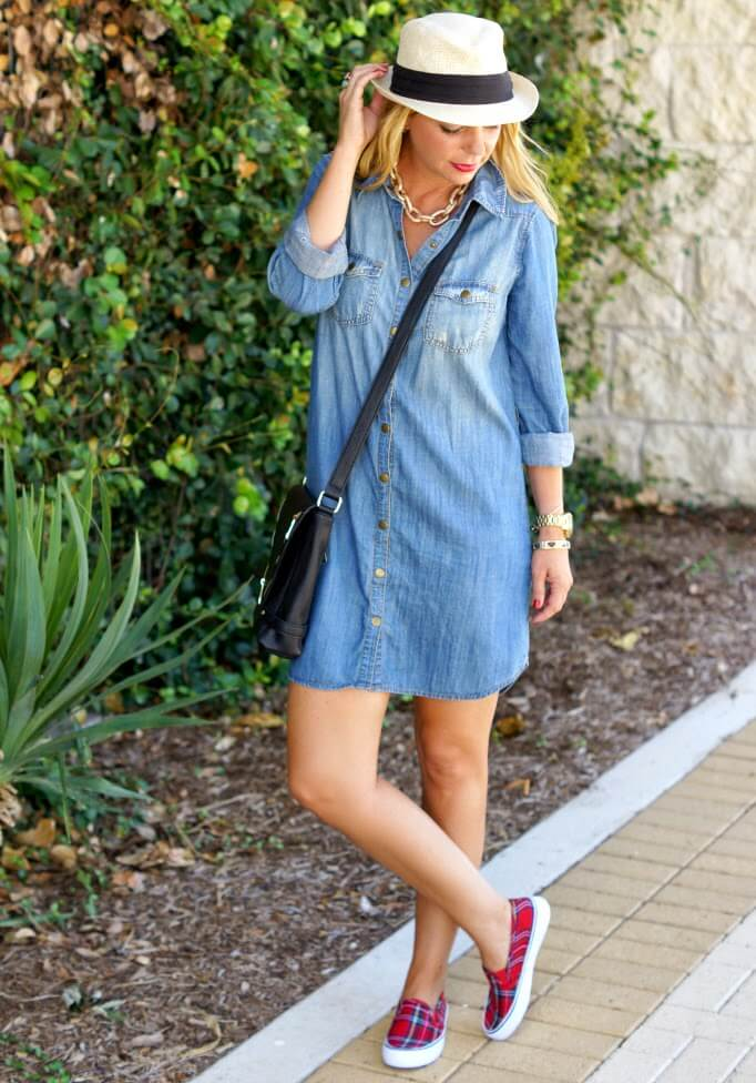 Blondie posing in denim shirt dress and sneakers with plaited print
