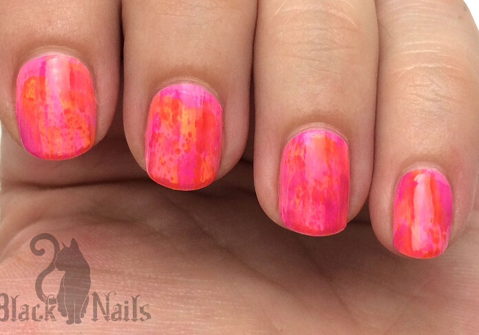 These bright neon nails are sure to brighten up any day. Using a technique called dry brushing, the artist used a base of bright pink and, wiping off all but a thin layer from the brush, painted two or three quick brushstrokes of orange polish on each nail.