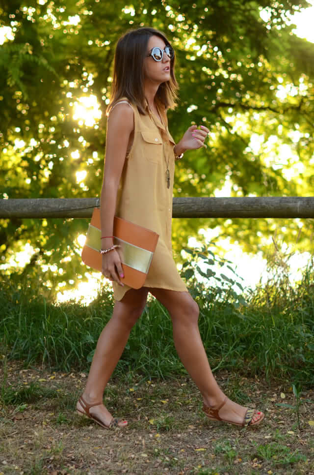 Pretty brunette outdoors in a lightweight shirtdress without sleeves