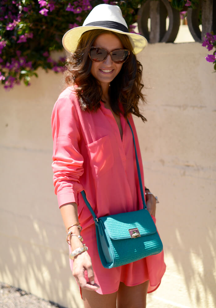 Smiling woman wearing coral shirtdress to create a beachy look