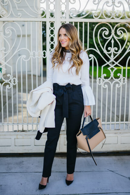 3704f42ef8e39 Chic woman is wearing a bell sleeve top and navy blue pants. For a business