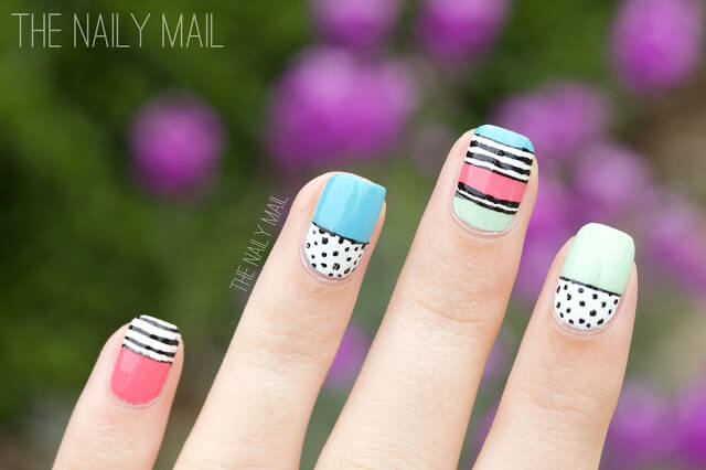 If you have a nail art pen, you can try this fun look at home. Using a combination of blue, pink, green, and white, your black nail art pen can easily draw stripes and dots to make exciting patterns.