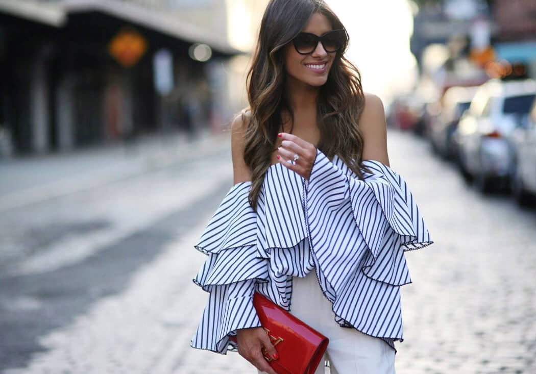 Brunette in striped offtheshoulder bell sleeve top