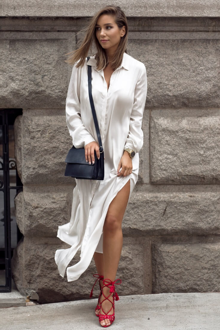 Amazing looking girl in a long satin shirt dress with high side slits and tassel detail heels.