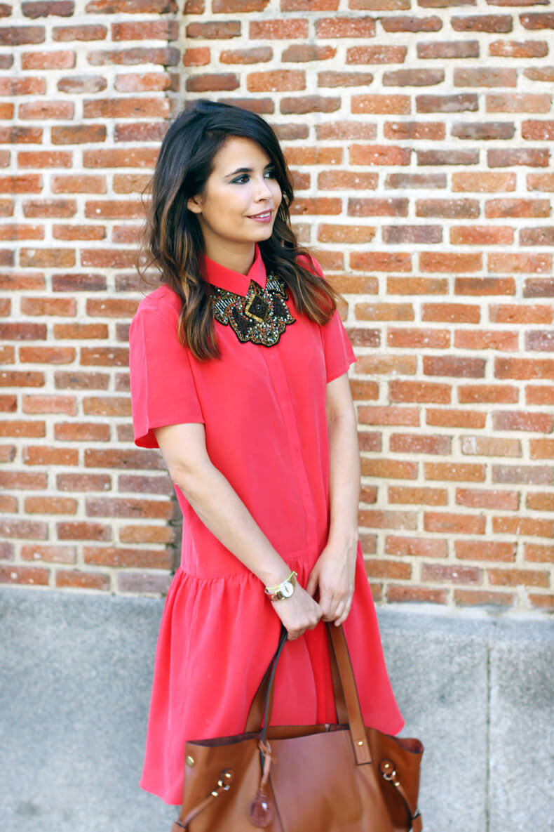 Girl wearing coral shirt dress and statement-making necklace like accent.