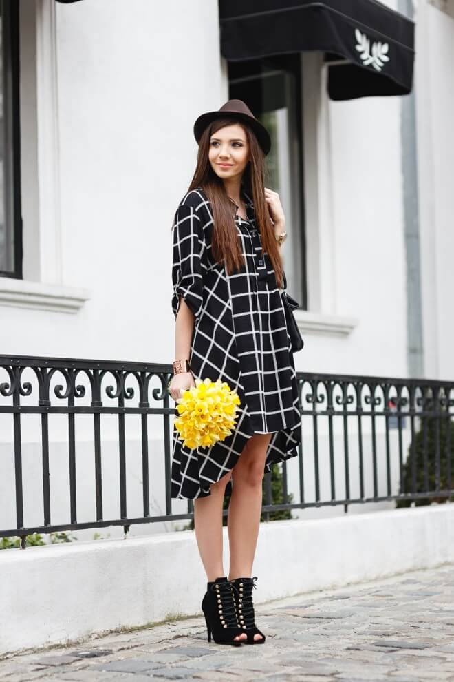 Young diva wearing checked pattern shirt dress and military inspired boots with an open toe.