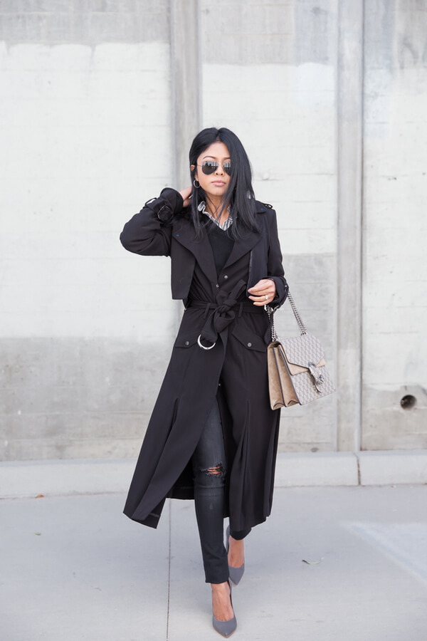 Beautiful lady with a layered outfit made of ribbed jeans, sweater and shirt dress worn like a trench.