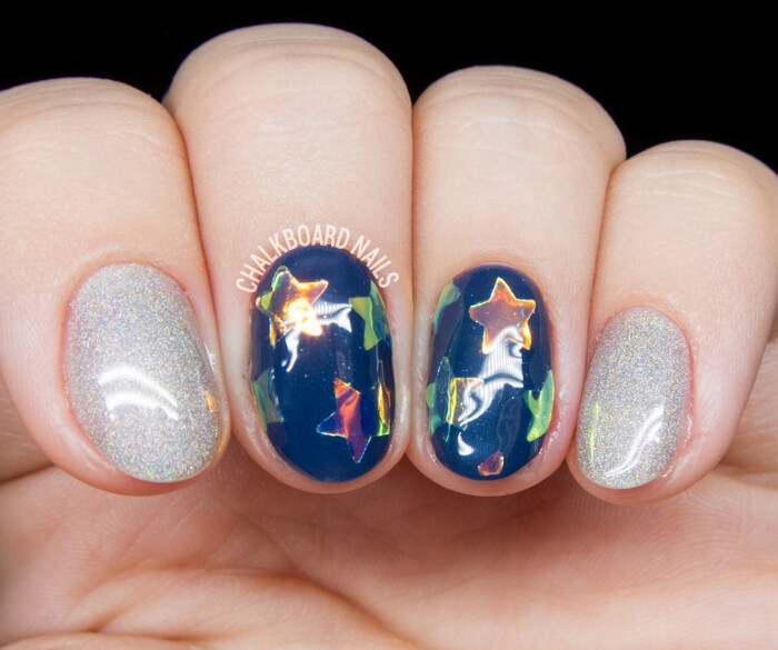 Get this shimmery polish effect on this manicure by hole punching or hand cutting out small star shapes into origami paper or cellophane and applying it to an opaque base, then sealing it in with a top coat.