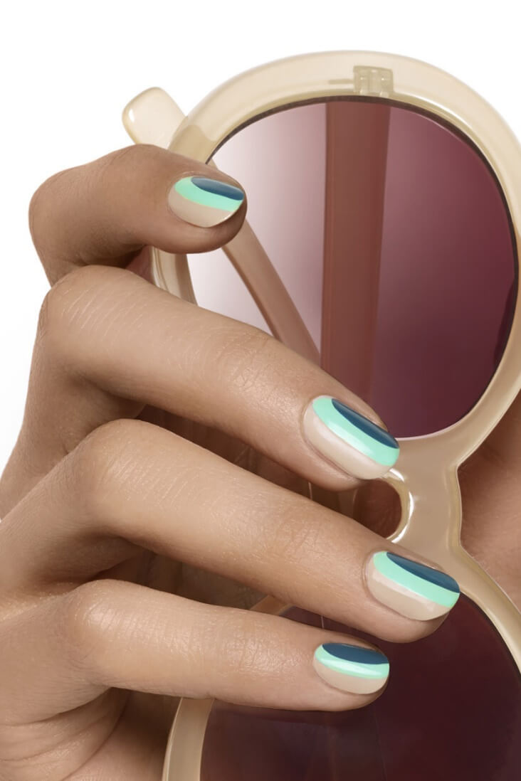 Get in the mood for spring with this simple, striped nail art featuring navy, mint green, and beige.