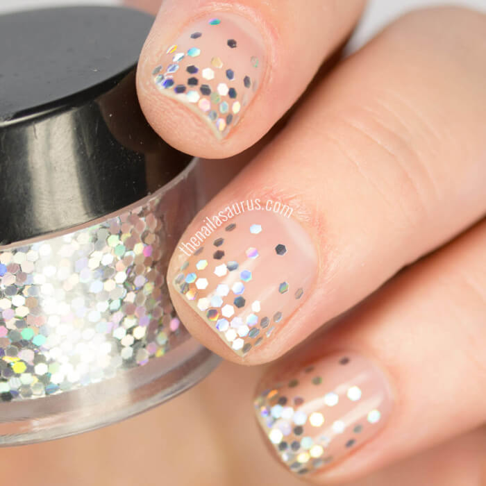 You only need two polishes for this nail art! Get this chunky glitter gradient by carefully concentrating silver glitter to the tips of your nails and finish with a clear top coat.