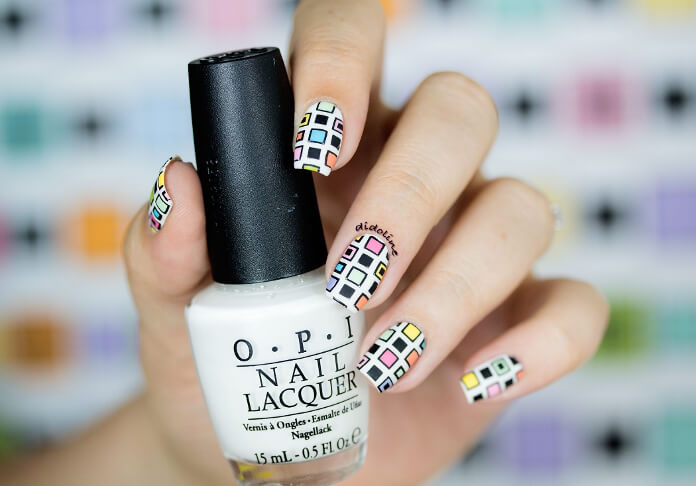 Using the stamping technique, you too can emulate these funky yet minimal nails. Alternate stamping big and small squares in different colors to get this look.
