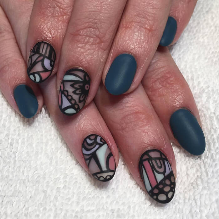 The ingenious take on the matte nail art trend. Bold, geometric and floral designs with pastel pink, green, and purple over a clear nail polish base created on two accent nails.