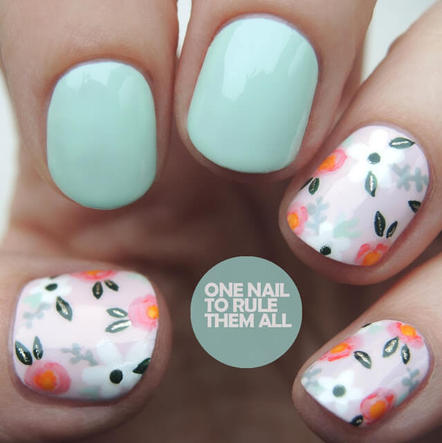 What a lovely vintage-inspired manicure! Using a base color of pale pink, nail artist has created a pink, orange and white floral design you might see on a vintage handbag or blouse. Don't forget the two robin's egg blue accent nails!