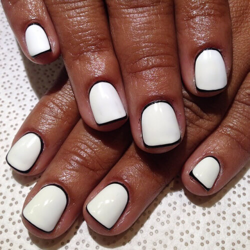 This outlined nail art is really trendy right now. Keep things monochromatic with using a thin black outline around your white base nail. Add a matte top coat for an artistic finish.