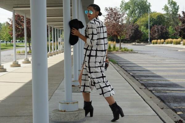 Stylish woman dressed in printed midi dress