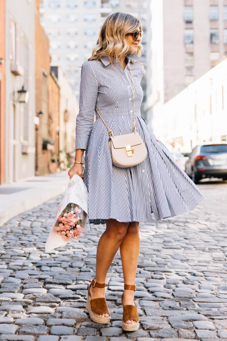 Stylish girl walking on the streets dress in striped A-line dress and brown platform