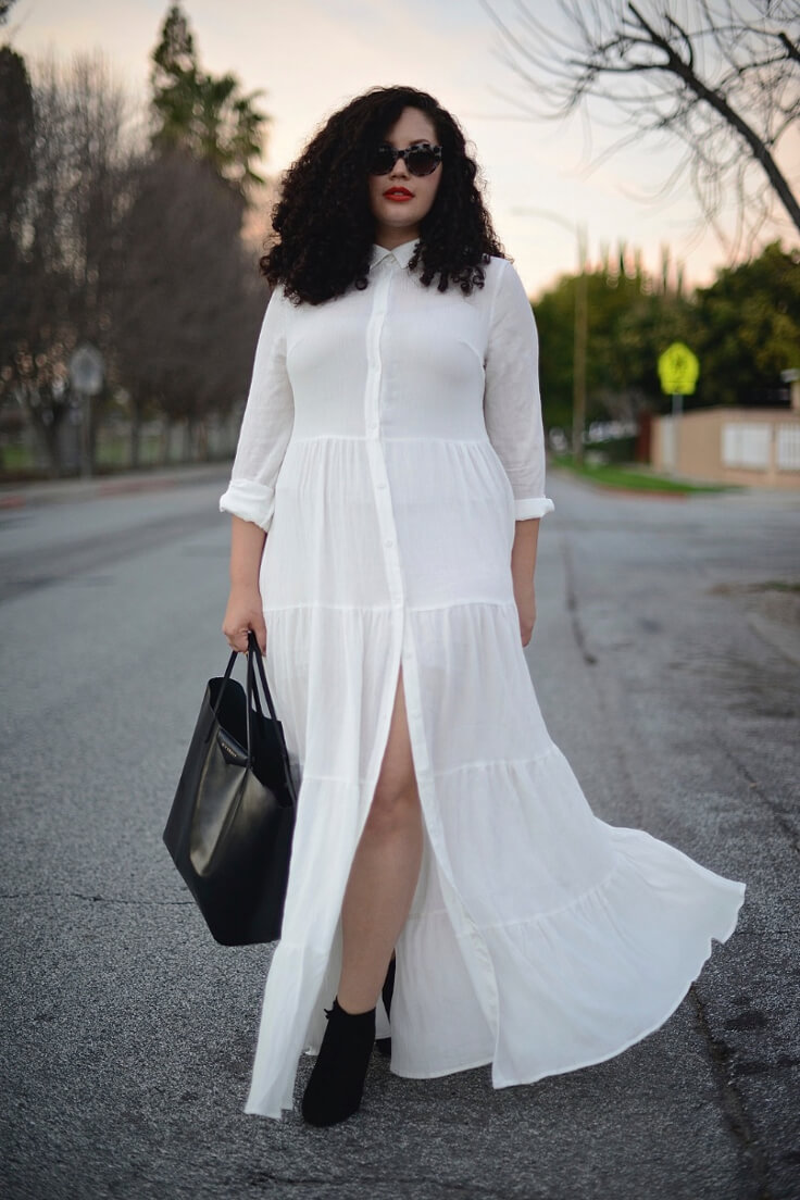 Wearing a long white ruffle dress
