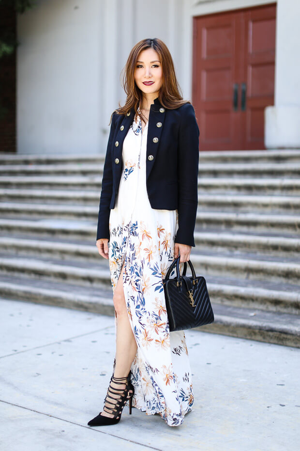 Young professional combining long shirt dress in floral print with a military blazer and black accessories.