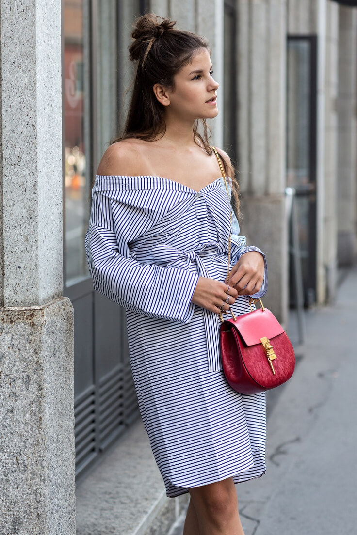 Woman wearing striped off-the-shoulder shirtdress