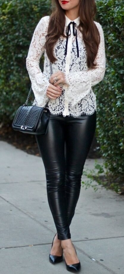 Edgy brunette is wearing black leather leggings and a white lace bell sleeve blouse. Combine innocent with edgy in this meeting of bell sleeves, white lace and black leather.